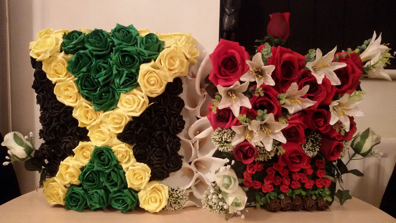 two beautiful flower arrangements, one in the colours of the jamaican flag
