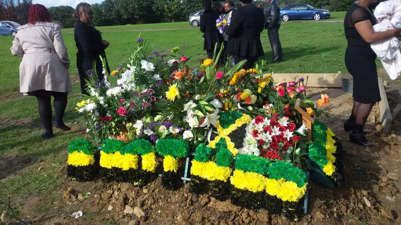 beautiful sympathy flowers in the colours of the jamaican flag